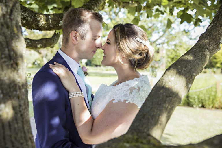 We are very lucky as wedding photographers that we are almost certain to be surrounded by beautiful things. I really try to use my environment to make a good picture even better. This lovely shot of Grace and Rory under a tree was taken as the sun was slowly setting and it really frames them and shows how relaxed they are. The champagne also helped........