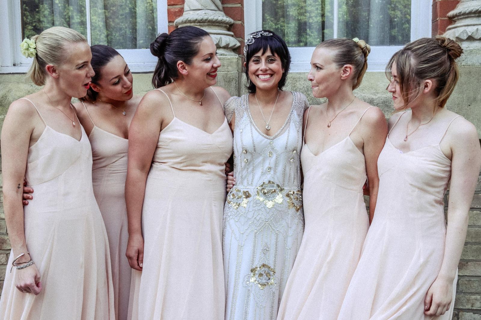 happy bride with her bridesmaid